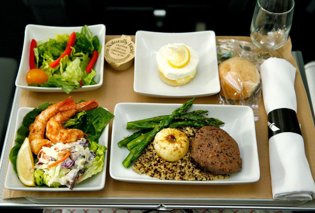 Shrimp Remoulade, seasonal greens, peppercorn crusted beef tenderloin, and lemon coconut layer cake served in the new premium economy cabin seating on the American Airlines new 787-9 Dreamliner at DFW Airport on Nov. 3, 2016.  (Nathan Hunsinger/The Dallas Morning News)   American Airlines new 787-9 Dreamliner at DFW Airport on Nov. 3, 2016.  (Nathan Hunsinger/The Dallas Morning News)