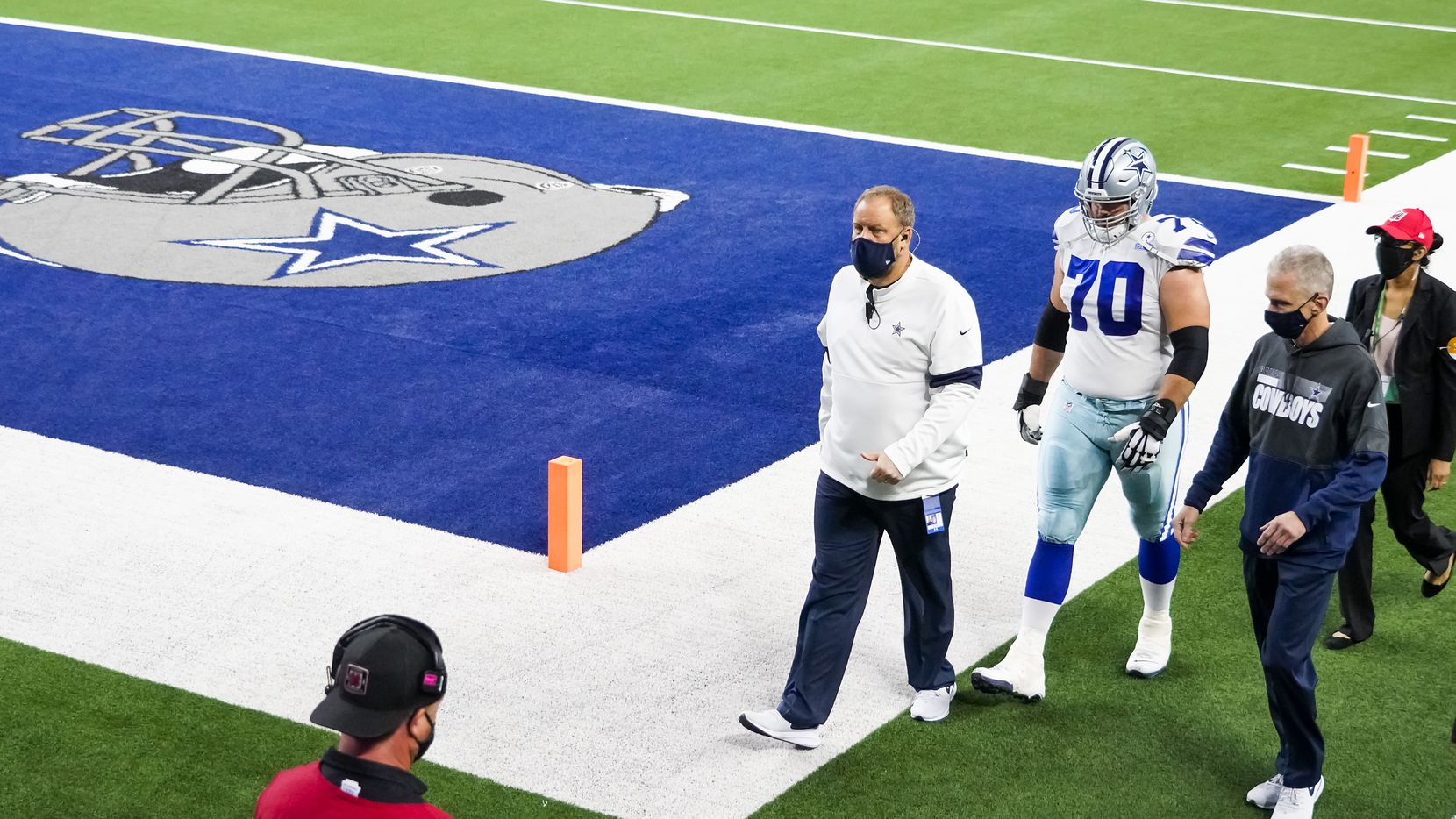 Dallas Cowboys offensive guard Zack Martin (70) head to the locker room during the second quarter of an NFL football game against the Arizona Cardinals at AT&T Stadium on Monday, Oct. 19, 2020, in Arlington.