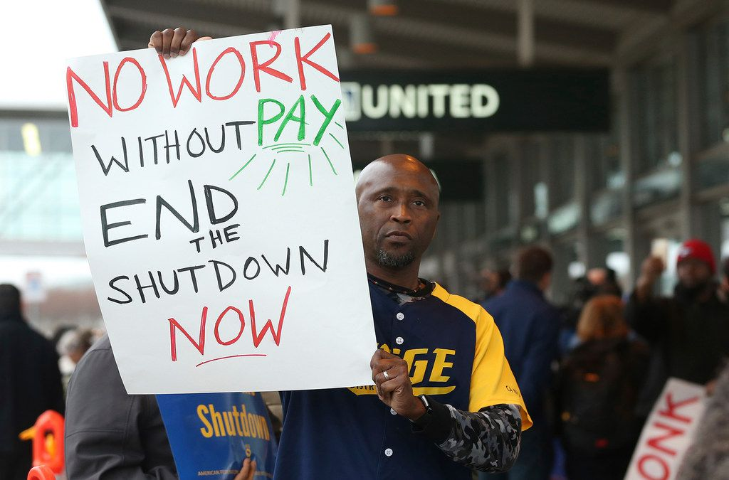 On Jan. 16, federal employee Marcus Walker joined other federal employees and supporters at the Sacramento International Airport calling for President Donald Trump and Washington lawmakers to end the partial government shutdown.