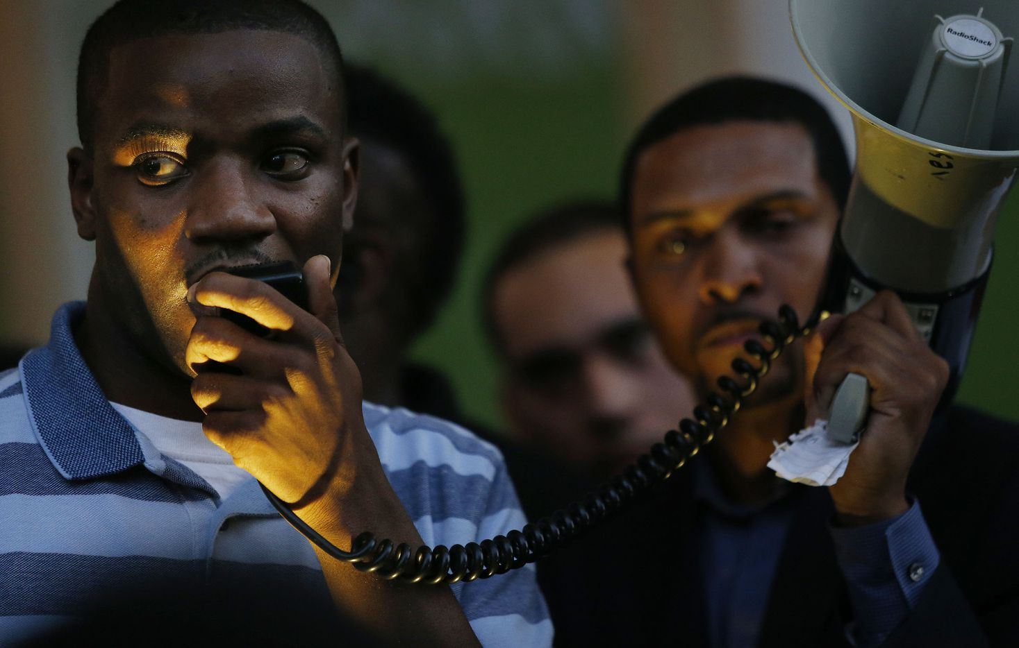 """Dominique Alexander, president and founder of Next Generation Action Network, speaks during a protest held by the Next Generation Action Network in downtown Dallas Thursday September 22, 2016. The protest, which started at the Main Street Garden Park and is called """"Enough is Enough,"""" is in reaction to recent shooting by police in Tulsa and Charlotte. (Andy Jacobsohn/The Dallas Morning News)"""