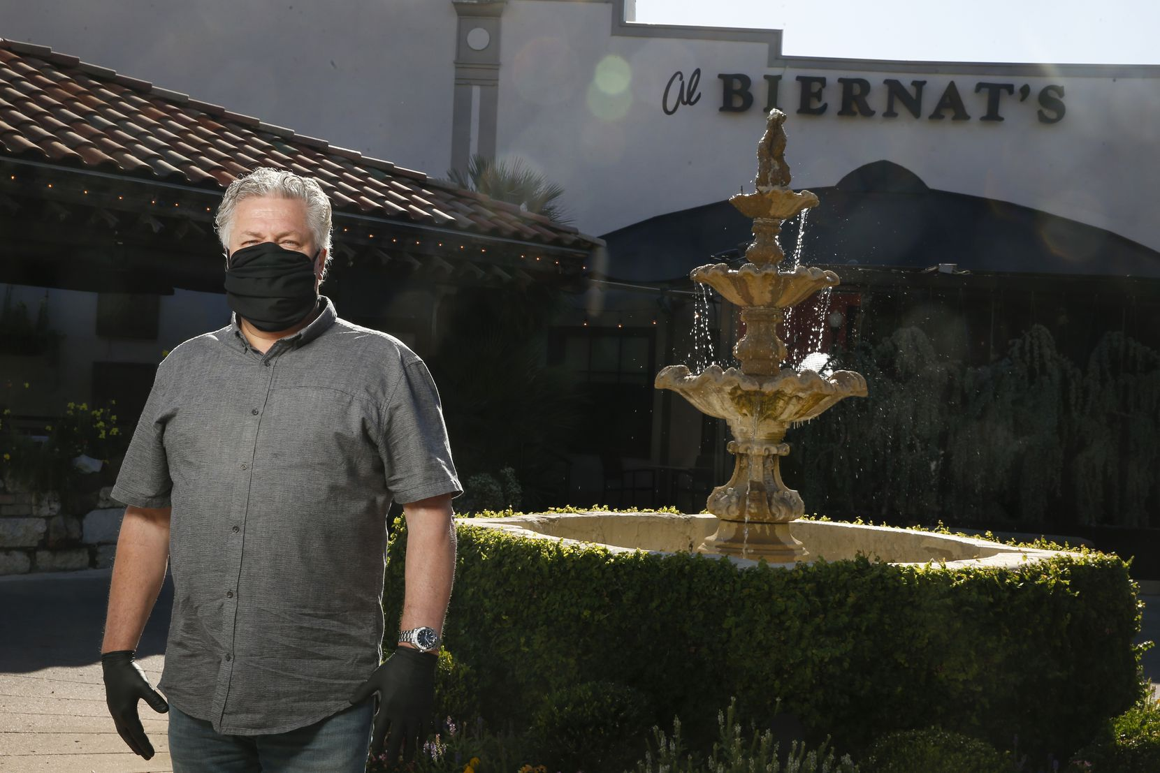 Al Biernat poses for a photograph outside the Highland Park location of his steakhouse, Al Biernat's.