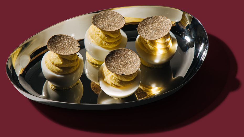 Many of the dishes at Dallas restaurant Tango Room come with the option of fancy add-ons like lobster, foie gras and caviar. Here's the deviled eggs wearing a slice of black truffle as a top hat.