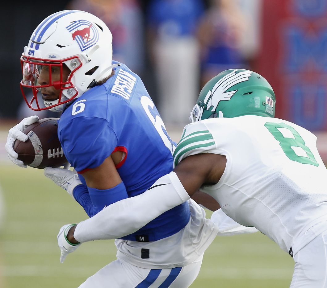 Southern Methodist Mustangs wide receiver Austin Upshaw (6) was unable to hang onto this pass defended by North Texas Mean Green defensive back John Davis Jr. (8) during the first half as SMU hosted UNT at Ford Stadium in Dallas on Saturday, September 11, 2021. (Stewart F. House/Special Contributor)