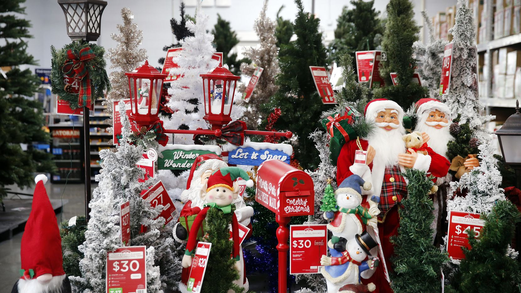 Christmas yard decorations and artificial trees fill the Walmart Supercenter on Lyndon B Johnson Freeway in Dallas, Thursday, October 29, 2020. (Tom Fox/The Dallas Morning News)