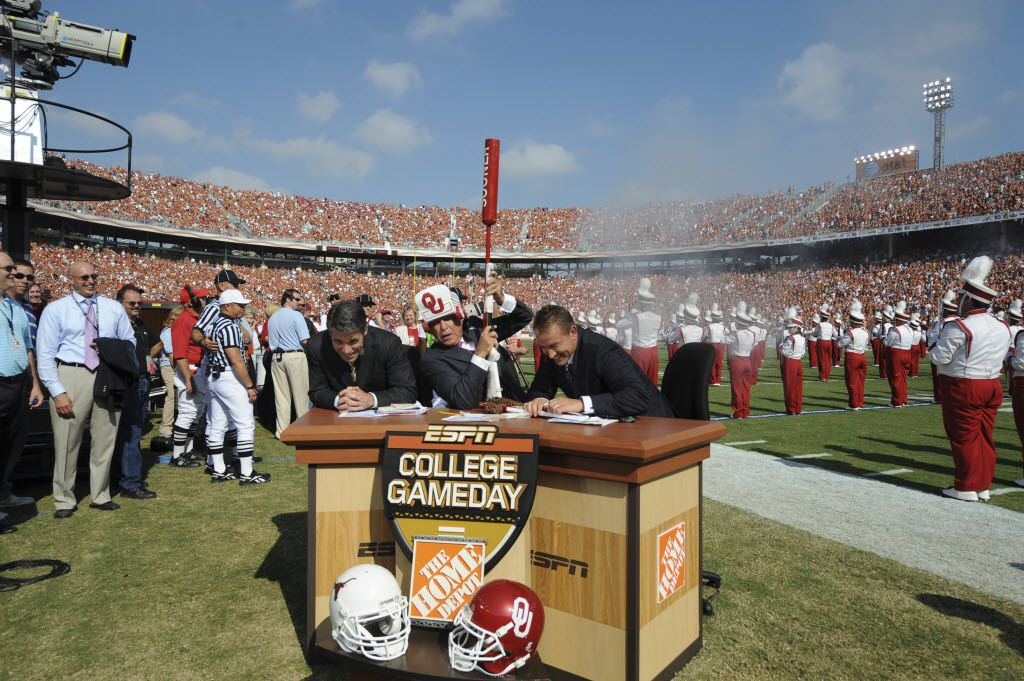 DALLAS, TX - OCTOBER 11, 2008: (L to R) ESPN College GameDay Host Chris Fowler, College Football Analyst Lee Corso and College Football Analyst Kirk Herbstreit on the on-site set of College GameDay prior to a game between the Texas Longhorns and the Oklahoma Sooners during their annual Red River Rivalry game at the Cotton Bowl..(Photo by Scott Clarke / ESPN) __ Caption: ESPN's Chris Fowler, Lee Corso and Kirk Herbstreit duck for cover on the floor of the Cotton Bowl during a College GameDay broadcast prior to the Texas-Oklahoma game on Oct. 11, 2008. Email: gleavell@dallasnews.com Phone: 8987 OrigName: 1318021671_0923077001318021671_0.jpg Name: gameday.jpg Byline: Courtesy ESPN Submitter: Garry Leavell Timestamp: 2011-10-07 16:07:51 Section: SPORTS_NS 10082011xSPORTS