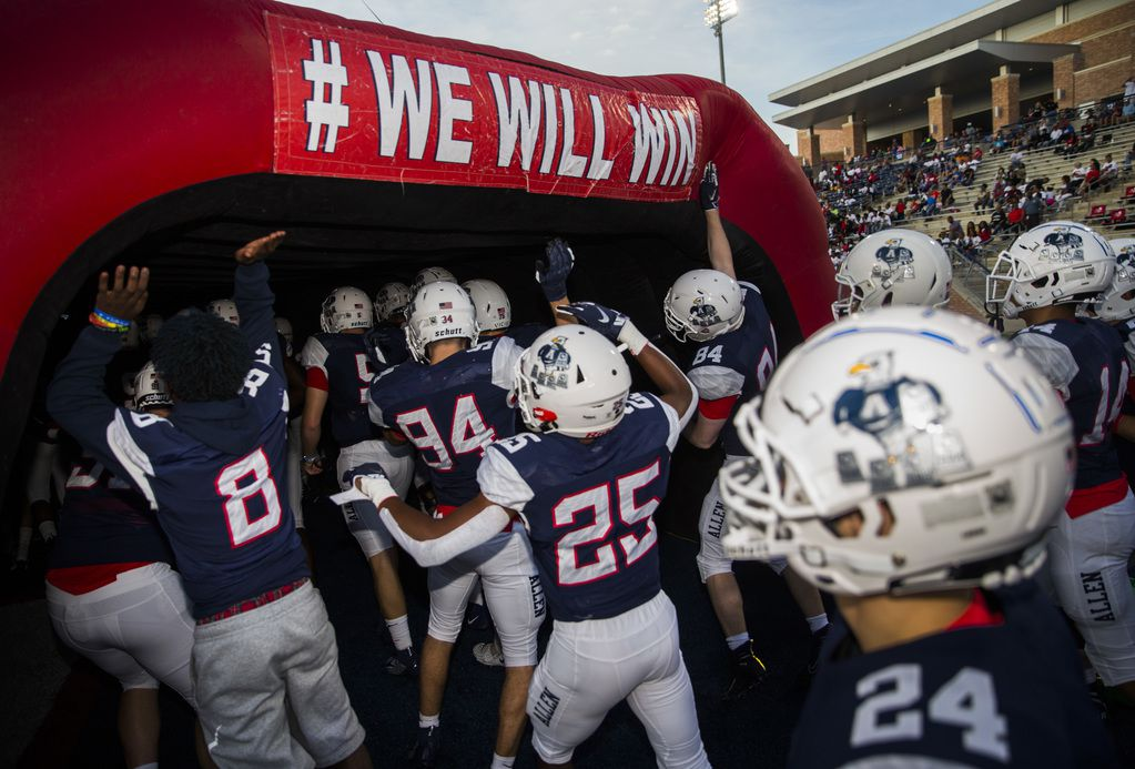 FILE - The Allen Eagles make their way to the field before a game against Cedar Hill on Friday, Aug. 30, 2019, at Eagle Stadium in Allen.