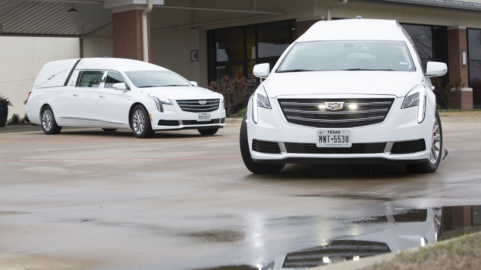 The hearses carrying Deja and Abbaney Matts, the sisters who were found dead in a dorm at Texas A&M-Commerce, leave the funeral service at North Cities United Pentecostal Church in Garland.