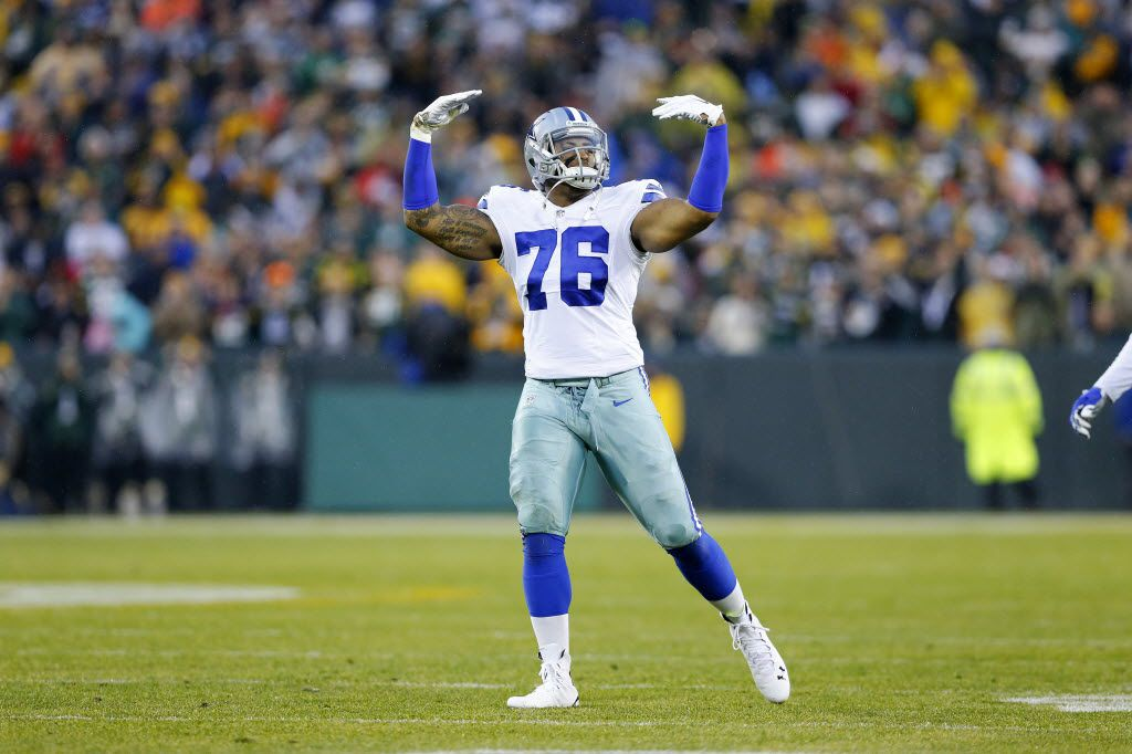 Dallas Cowboys defensive end Greg Hardy (76) reacts to the music and the crowd during the first half against the Green Bay Packers at Lambeau Field in Green Bay, Wisconsin, Sunday, December 13, 2015. (Tom Fox/The Dallas Morning News)