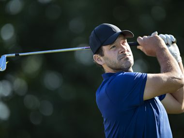Tony Romo tees off on the 2nd hole during the rained delayed second round of the Korn Ferry Tour Veritex Bank Championship at the Texas Rangers Golf Club on April 24, 2021 in Arlington, Texas.