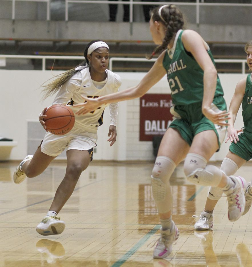 Plano East guard Kayla Cooper (11) cuts inside the defense of Southlake Carroll guard Kylie Swanson (21) as she drives the lane during first half action. Plano East won 56-42 to advance. The two teams played their Class 6A regional semifinal girls playoff basketball game at Loos Field House in Addison on February 27, 2021. (Steve Hamm/ Special Contributor)