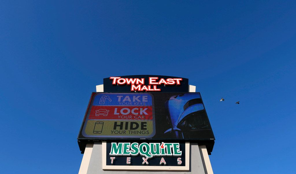 "A ""Take, Lock, Hide"" sign is seen at Town East Mall in Mesquite."