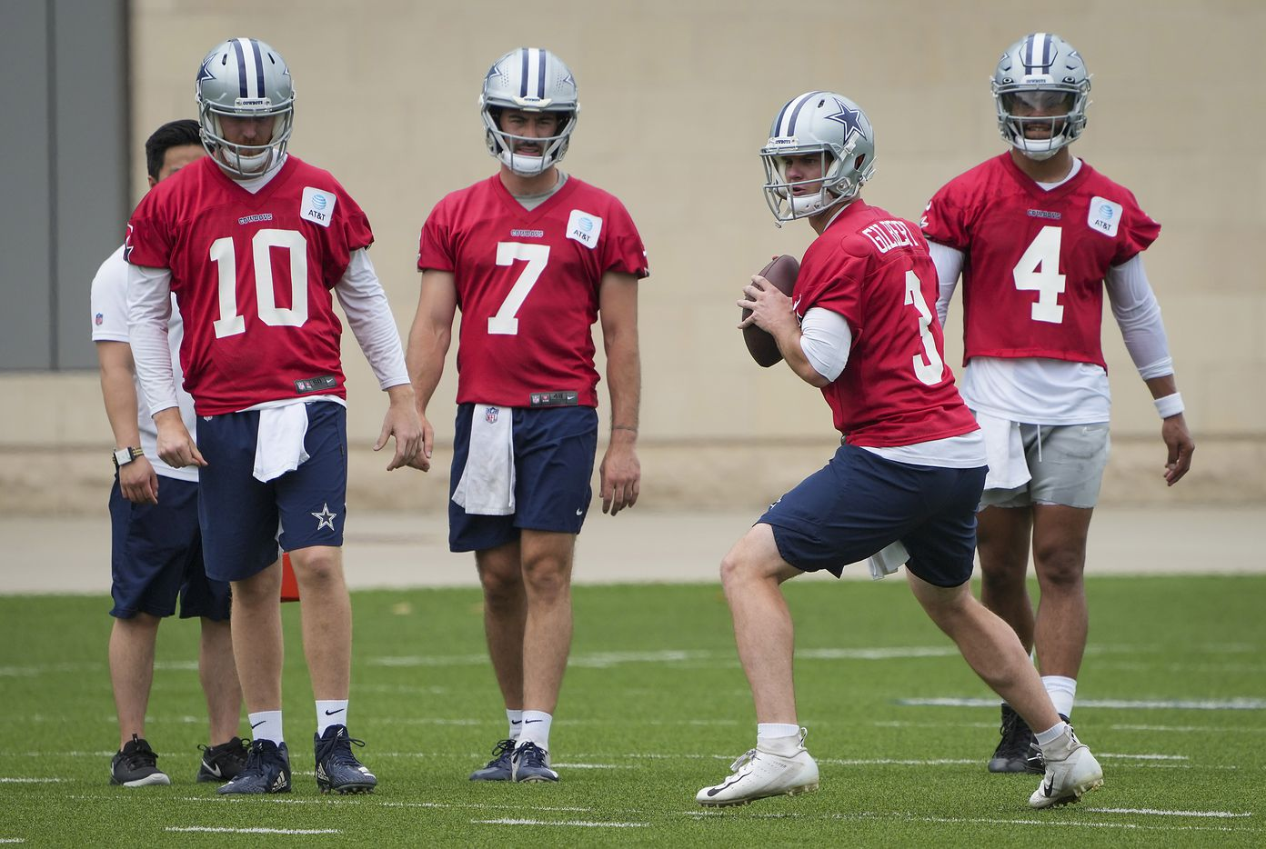 Dallas Cowboys quarterbacks Cooper Rush (10), Ben DiNucci (7), Garrett Gilbert (3) and Dak Prescott (4) participate in a drill during a minicamp practice at The Star on Wednesday, June 9, 2021, in Frisco. (Smiley N. Pool/The Dallas Morning News)