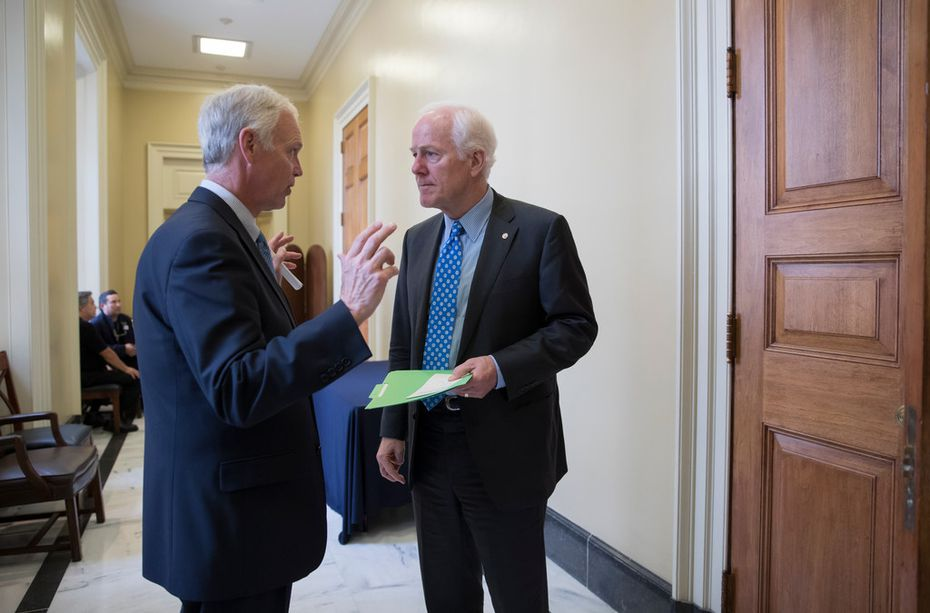 Sen. Ron Johnson, R-Wis., (left) chairman of the Senate Homeland Security and Governmental Affairs Committee, confers with Senate Majority Whip John Cornyn, R-Texas.