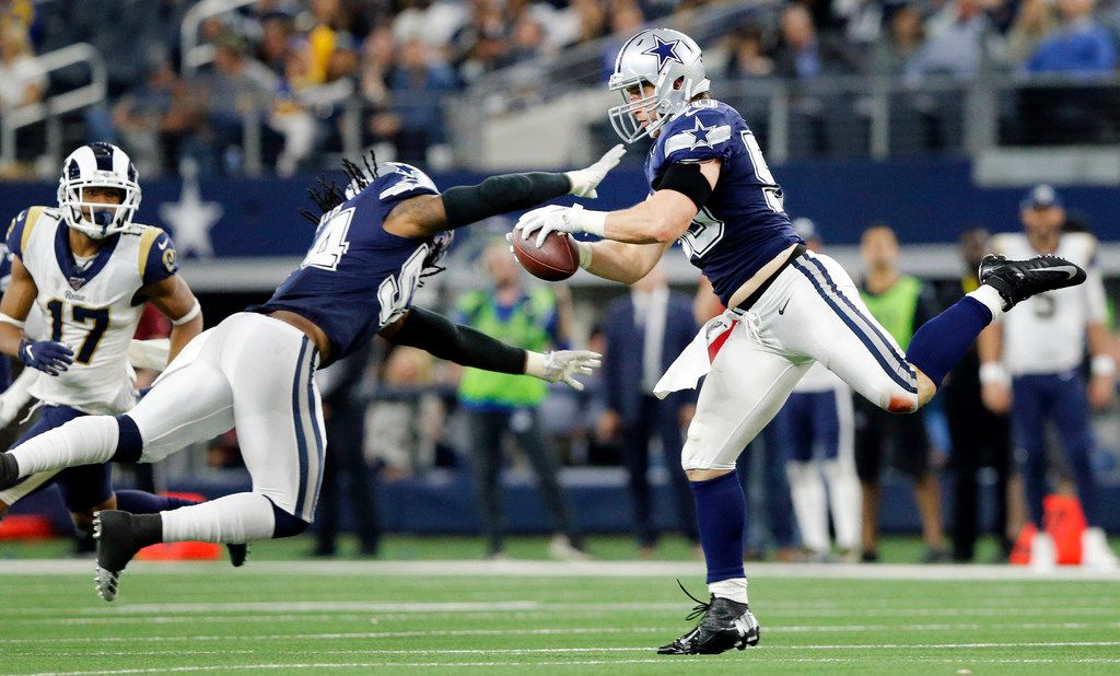 Dallas Cowboys outside linebacker Sean Lee (50) pulls down a second quarter interception from Los Angeles Rams quarterback Jared Goff at AT&T Stadium in Arlington, Texas, Sunday, December 15, 2019. (Tom Fox/The Dallas Morning News)
