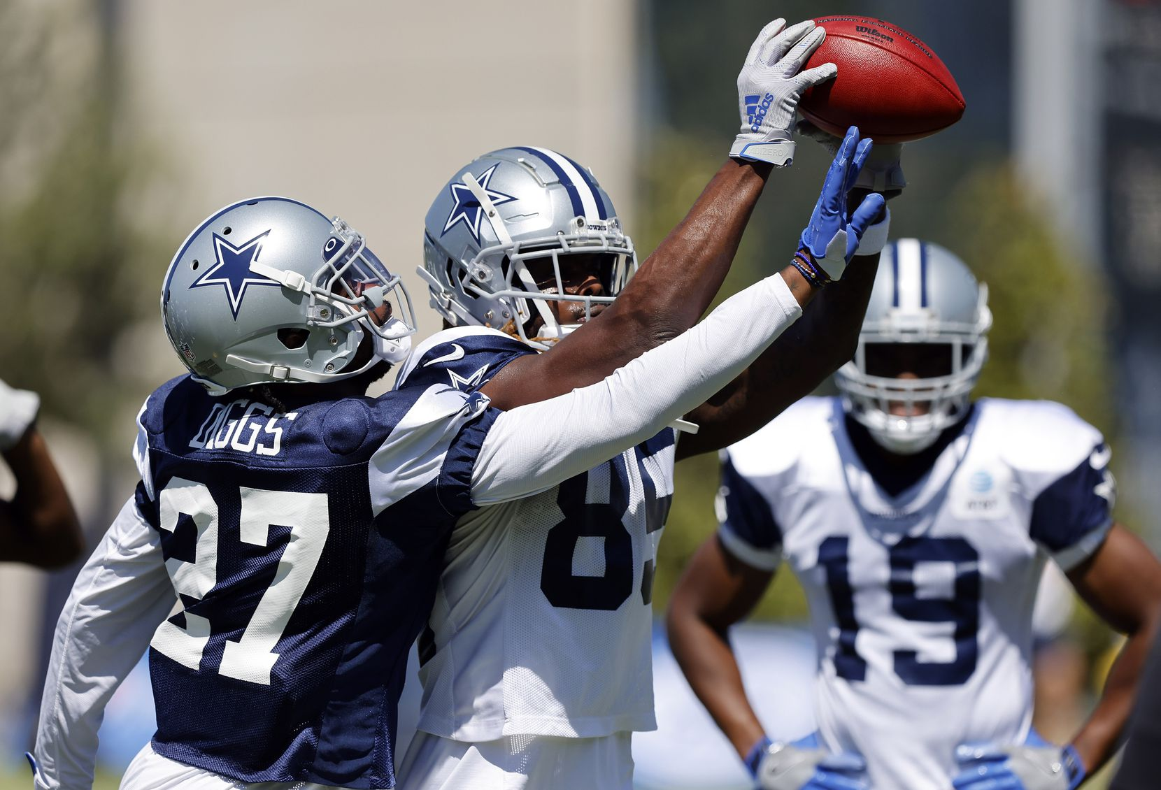 Dallas Cowboys cornerback Trevon Diggs (27) trees to knock the ball from Dallas Cowboys wide receiver Noah Brown's (85) hands during Training Camp practice drills at The Star in Frisco, Texas, Tuesday, August 24, 2021.