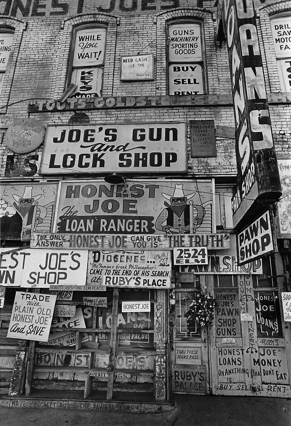 Sep. 8, 1972 - A funeral wreath hung on the door of Honest Joe's Pawn Shop at 2524 Elm St. in Deep Ellum after the death of owner Rubin Goldstein.