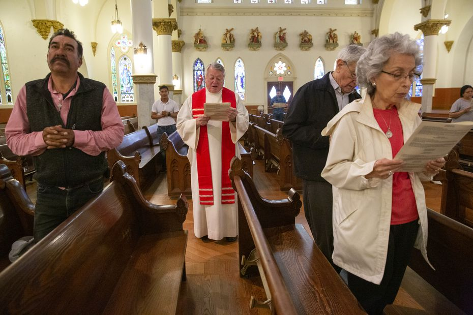 The Rev. Stephen Bierschenk (center) of Dallas' Cathedral Shrine of the Virgin of Guadalupe led the congregation in a reading of the Stations of the Cross on March 13, 2020, in Dallas.