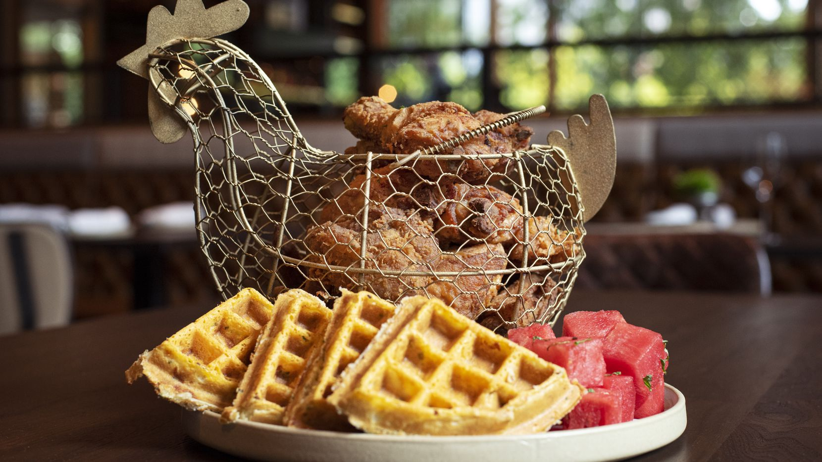 The Whole Bird at Yardbird Southern Table & Bar in Uptown Dallas is a stack of fried chicken served with watermelon and waffles. The restaurant opened Sept. 17, 2020.