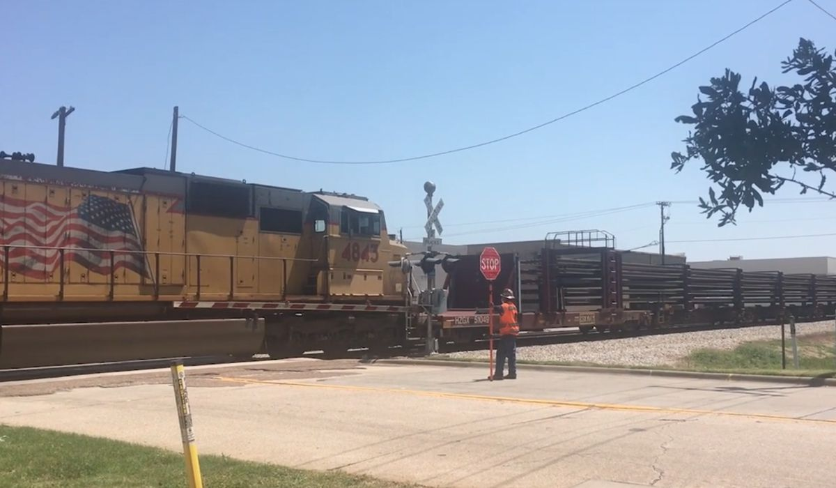 Rails for DART's Silver Line project are being delivered by train.