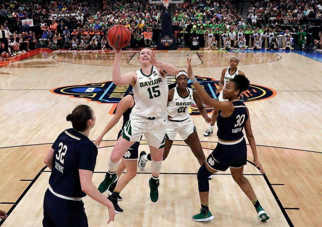 Baylor's Lauren Cox (15) goes up for a shot past Notre Dame's Mikayla Vaughn (30) and Jessica Shepard (32) during the second half of the Final Four championship game of the NCAA women's college basketball tournament Sunday, April 7, 2019, in Tampa, Fla.