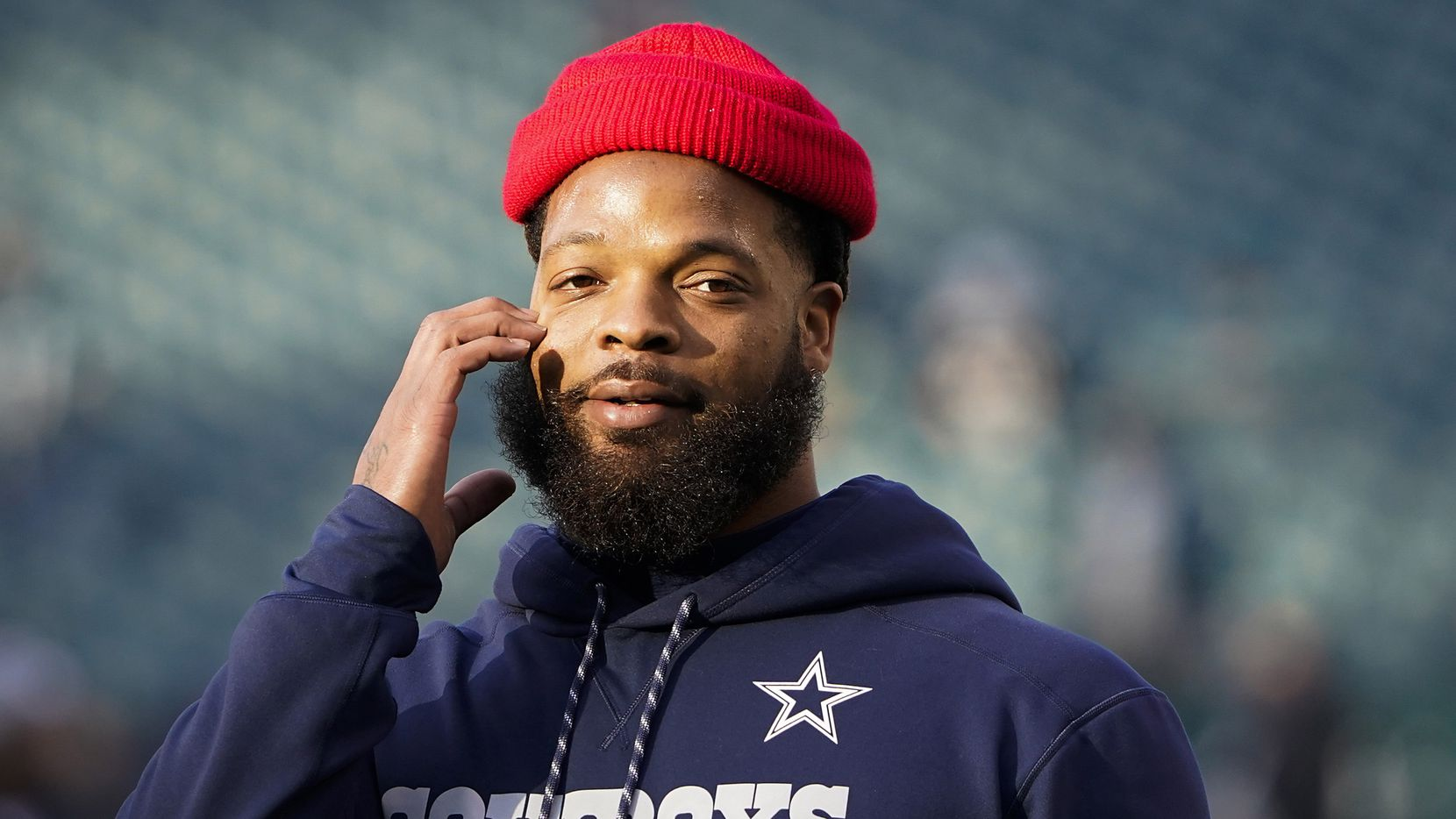 Dallas Cowboys defensive end Michael Bennett warms up before an NFL football game against the Philadelphia Eagles at Lincoln Financial Field on Sunday, Dec. 22, 2019, in Philadelphia.
