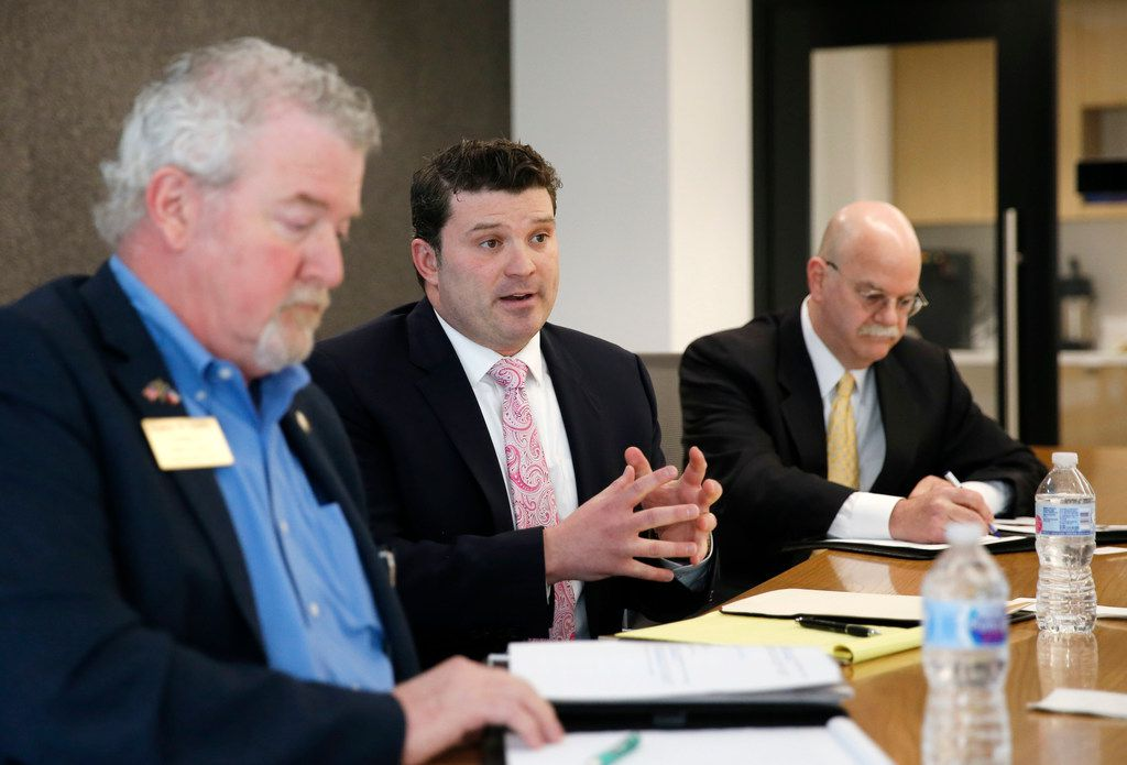 """Dallas attorney J.J. Koch, center, answers questions in an editorial board meeting as former Garland City Council member Stephen Stanley (left) listens and former state District Judge Vickers """"Vic"""" Cunningham (right) takes notes at The Dallas Morning News in Dallas on Friday, February 9, 2018. All are running for the Republican nomination for Dallas County commissioner in District 2. (Vernon Bryant/The Dallas Morning News)"""