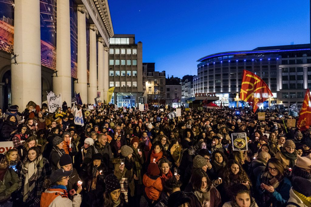 People hold candles as they protest in solidarity with the Women's March in Washington at the same time as the U.S. Presidential inauguration, in Brussels on Friday, Jan. 20, 2017. The event organized by a multicultural grassroots coalition of women in the Brussels area seek to counter the rise of the far right agenda – be it in Europe, the U.S. or beyond. (AP Photo/Geert Vanden Wijngaert)