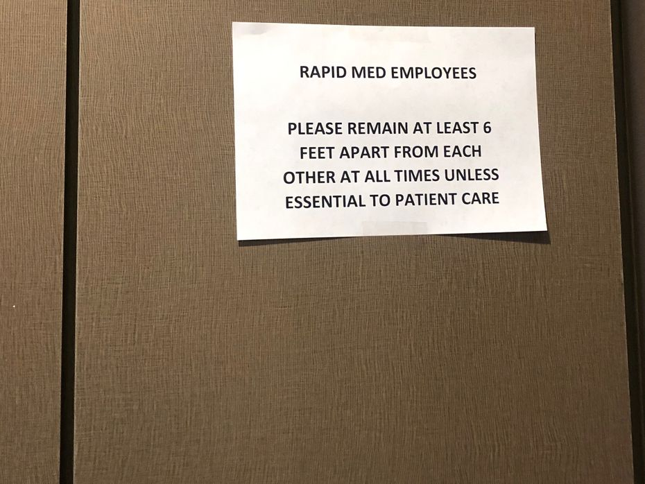 Before Rapid Med employees were told to test for the coronavirus two weeks ago, management did not call a meeting or provide instruction on safe specimen collection. But this sign was posted inside one of the facilities.