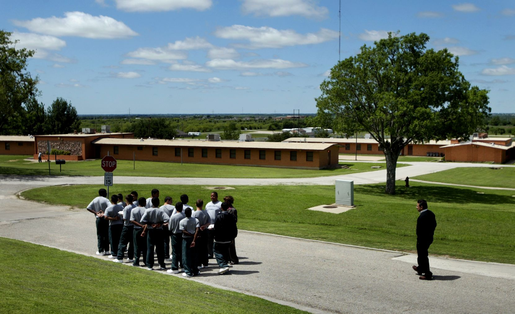 At the Gainesville State School, a group of male inmates prepared to march back to their dorm following lunch, in 2007.