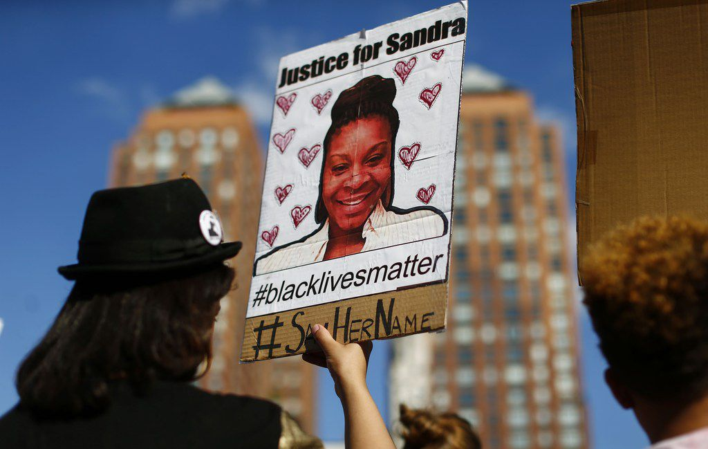 During a rally on Union Square in New York in August 2015, a woman held a poster bearing a portrait of  Sandra Bland, a 28-year-old black woman who killed herself in a Texas jail cell the previous month.