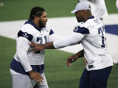 Dallas Cowboys offensive tackle La'el Collins (71) and Dallas Cowboys offensive tackle Tyron Smith (77) working out together as the team practices during training camp at the Dallas Cowboys headquarters at The Star in Frisco, Texas on Sunday, August 23, 2020.