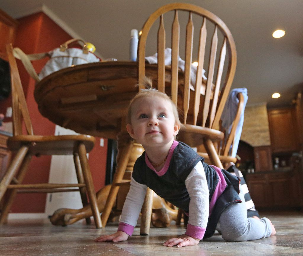 One-year-old Kelcey McKissack played at her grandmother's home in Nevada on Thursday. (Louis DeLuca/Staff Photographer)