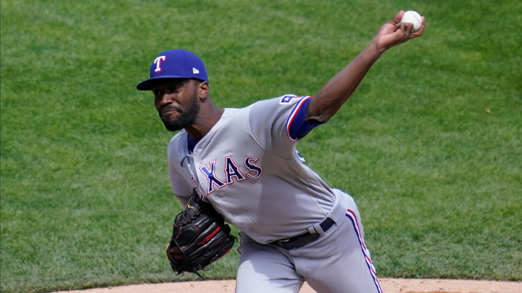 Texas Rangers' pitcher Taylor Hearn throws in the eighth inning of a baseball game against the Minnesota Twins, Thursday, May 6, 2021, in Minneapolis. (AP Photo/Jim Mone)