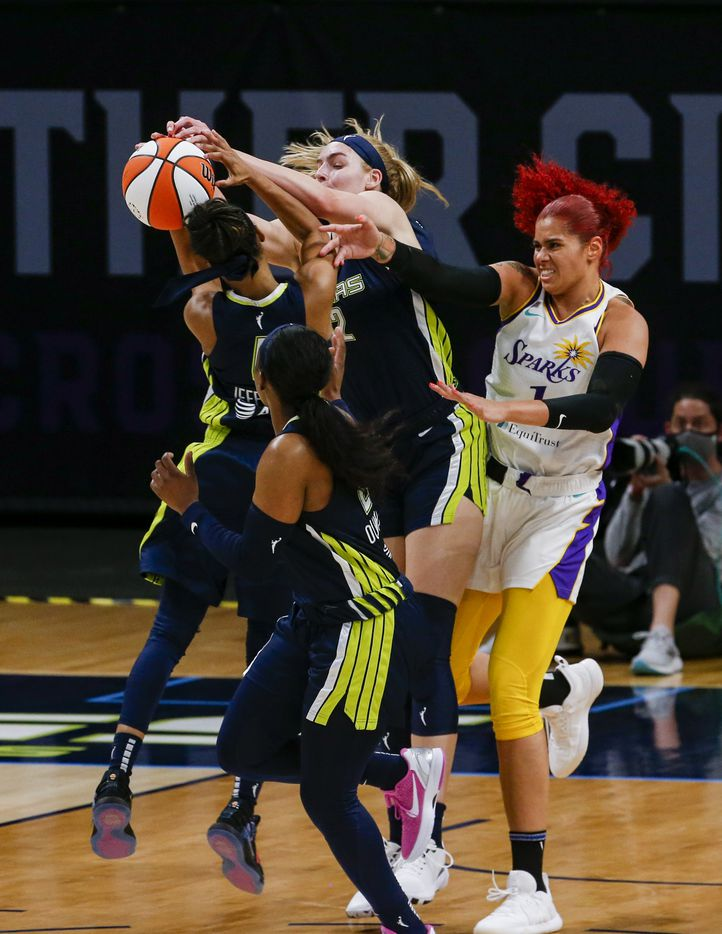 Los Angeles Sparks center Amanda Zahui B (1) fights the Dallas Wings for the ball during the second quarter at College Park Center on Tuesday, June 1, 2021, in Arlington. (Juan Figueroa/The Dallas Morning News)