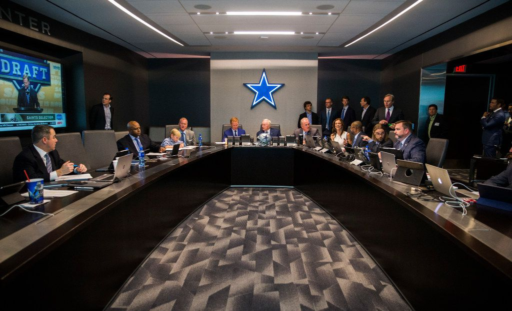 Dallas Cowboys head coach Jason Garrett, owner Jerry Jones, Executive Vice President and CEO Stephen Jones, Executive Vice President and Chief Brand Officer Charlotte Jones Anderson and other executives discuss players in the war room during round one of the 2017 NFL Draft on Thursday, April 27, 2017 at The Star in Frisco, Texas. (Ashley Landis/The Dallas Morning News)