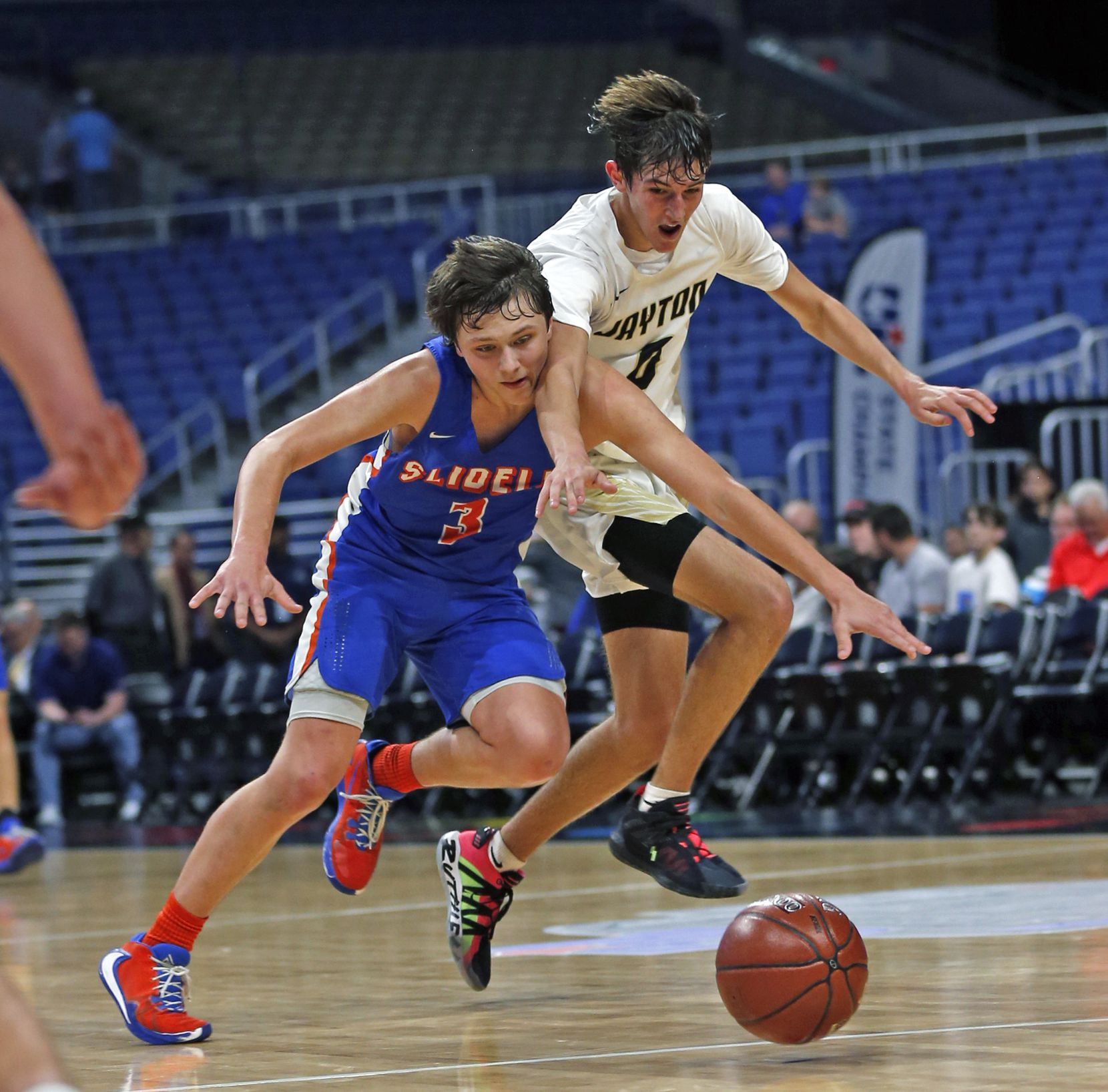 Slidell guard Brock Harwell #3 goes for a loose ball with Jayton center Alex Chisum #4. Slidell defeated Jayton 45-28 in a Class 1A semifinal game on Thursday, March 12, 2020 at the Alamodome.
