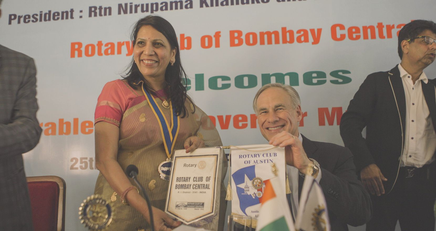 Texas Gov. Greg Abbott and Nirupama Khandke, president of the Rotary Club of Bombay Central, exchanged Rotary Club insignias after he spoke to her group in South Mumbai, India, on Sunday afternoon.