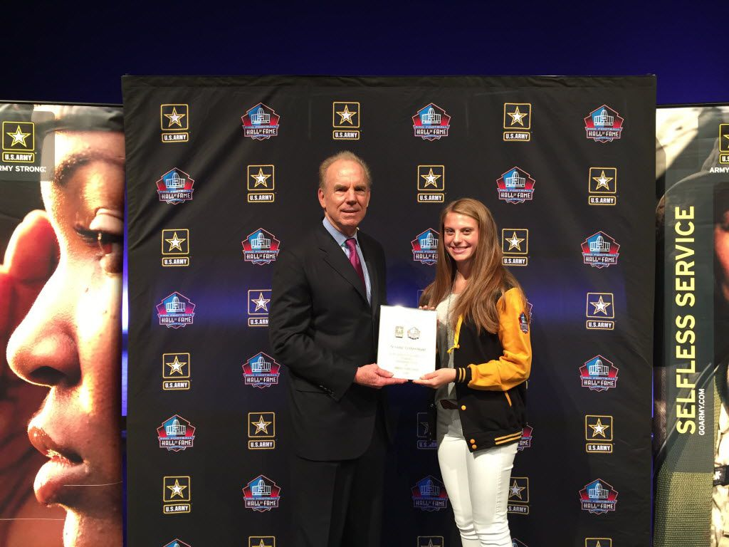 Former Dallas Cowboys quarterback Roger Staubach (left) was at Greenhill on Wednesday, May 11 to recognize Greenhill sophomore Ariana Luterman as a U.S. Army Pro Football Hall of Fame Award for Excellence finalist.