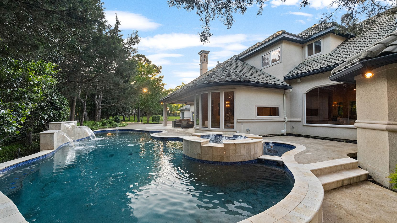 A home with a pool, such as the one at 1804 Leeds in Southlake, captures the essence of summer and Allie Beth Allman agents have listing options for you.