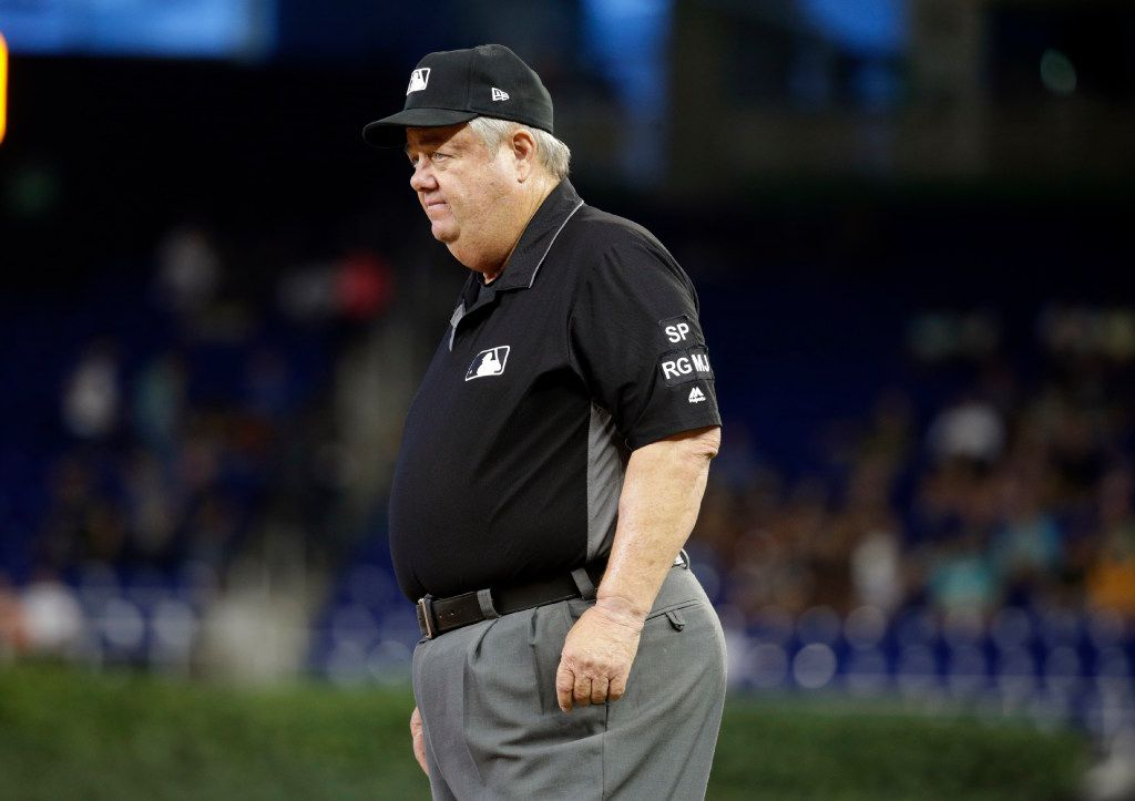Umpire Joe West works first base during a baseball game between the Cincinnati Reds and Miami Marlins, Thursday, July 27, 2017, in Miami. (AP Photo/Lynne Sladky)