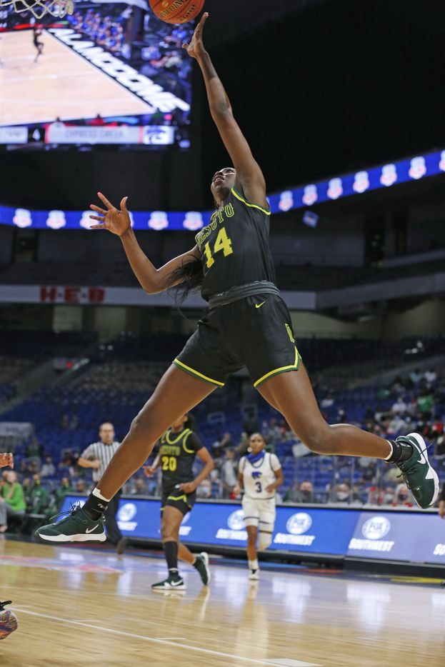 DeSoto Amina Muhammad #14 drives for two. DeSoto vs. Cypress Creek girls basketball Class 6A state championship game on Thursday, March 12, 2021 at the Alamodome.