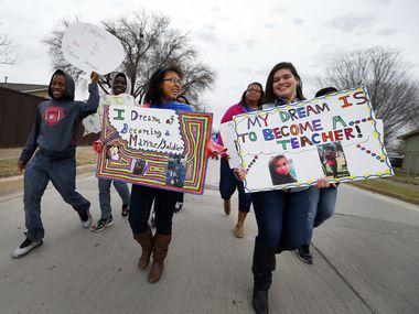 Kids from Mount Moriah Missionary Baptist Church carry signs of their dreams in the 27th Annual MLK Parade and March sponsored by the NAACP Garland Unit in Garland, on Saturday, January 16, 2016.
