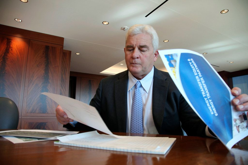 Energy Transfer CEO Kelcy Warren reviews documents about the Dakota Access Pipeline in November. The oil pipeline mired in controversy after thousand of protesters have sought to block its expansion underneath a water source close to the Standing Rock Sioux Indian Reservation.  (AP Photo/John L. Mone)