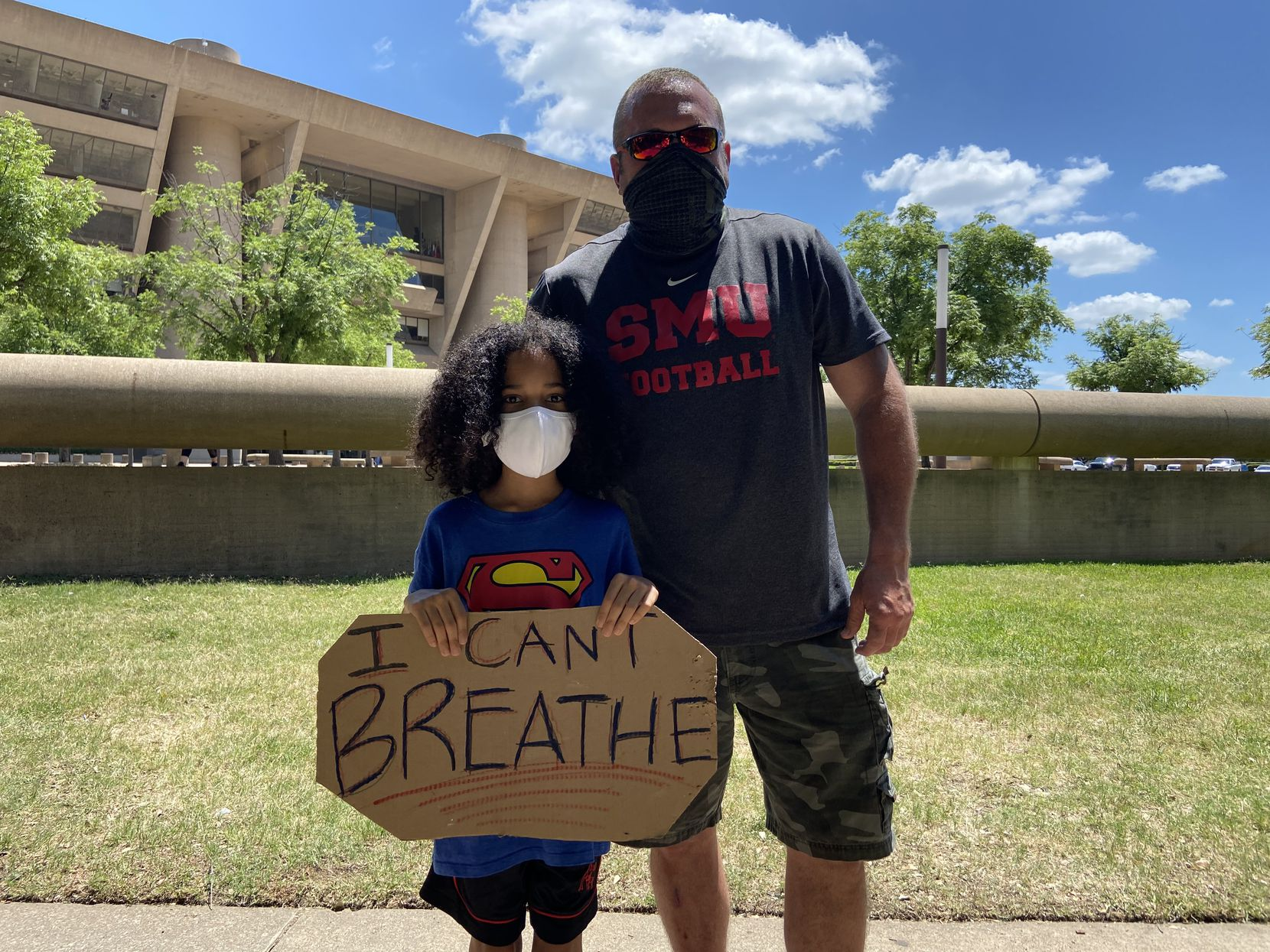 Max Nady (left) and his father Scott Nady protest outside Dallas City Hall on June 5, 2020.