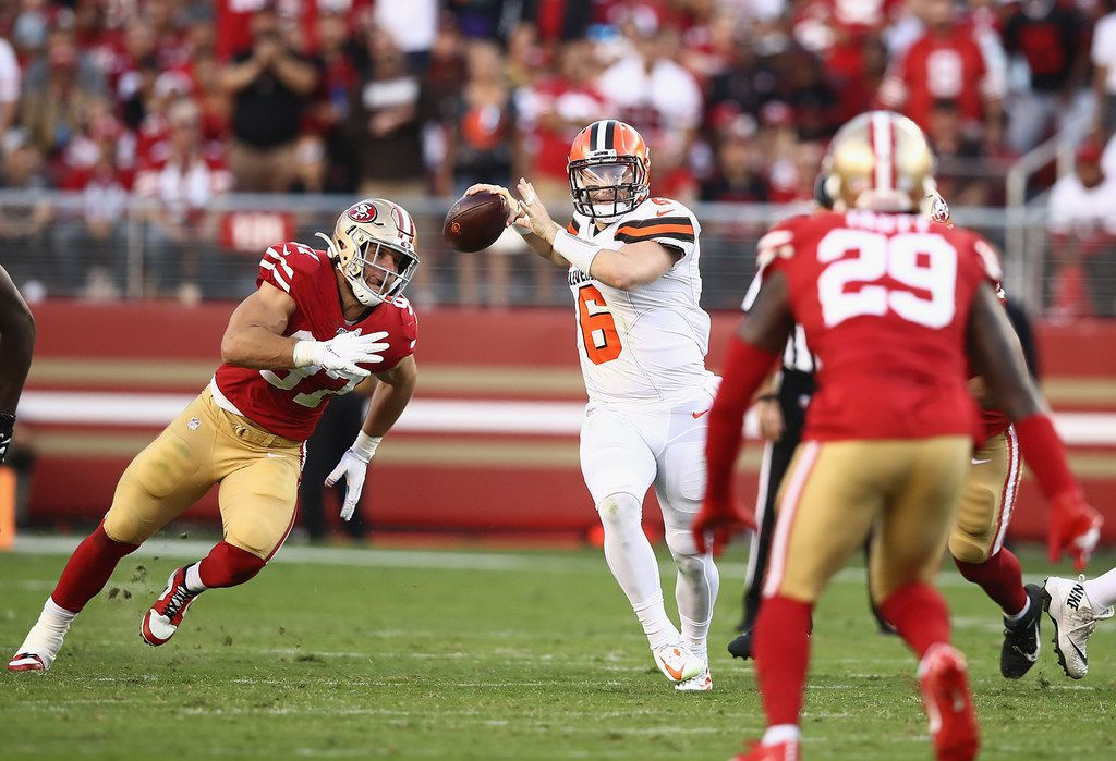 SANTA CLARA, CALIFORNIA - OCTOBER 07: Quarterback Baker Mayfield #6 of the Cleveland Browns is pursued Nick Bosa #97 of the San Francisco 49ers during the game at Levi's Stadium on October 07, 2019 in Santa Clara, California.