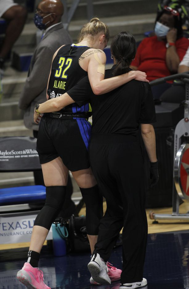 Dallas Wings center Bella Alarie (32) leaves the court with the assistance of a team trainer during first half action against the Atlanta Dream. The two teams played their WNBA game at College Park Center on the campus of UT-Arlington on September 5, 2021. (Steve Hamm/ Special Contributor)