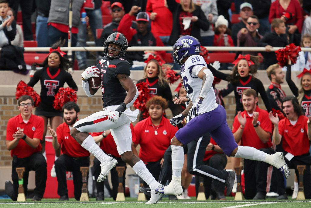 Texas Tech's RJ Turner (2) looks back on his way to scoring a touchdown during the first half of an NCAA college football game against TCU, Saturday, Nov. 16, 2019, in Lubbock, Texas.