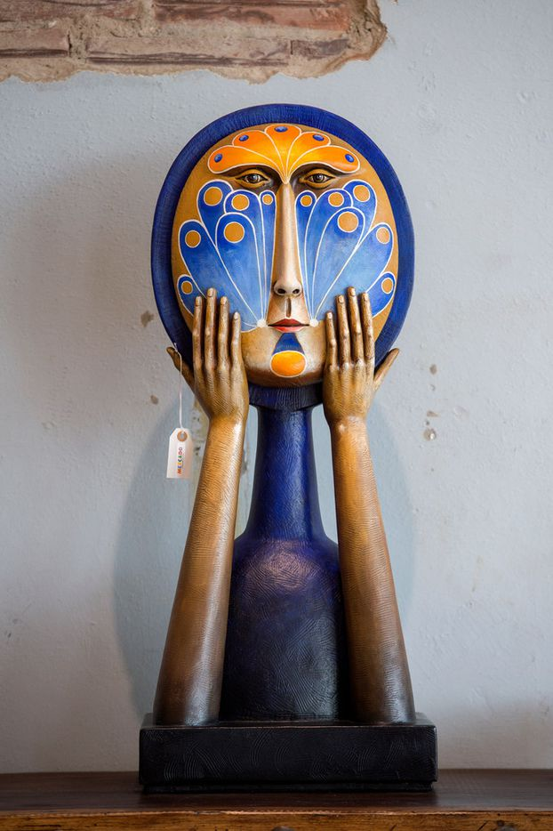 Face With Hands, a resin sculpture by Mexican artist Sergio Bustamante