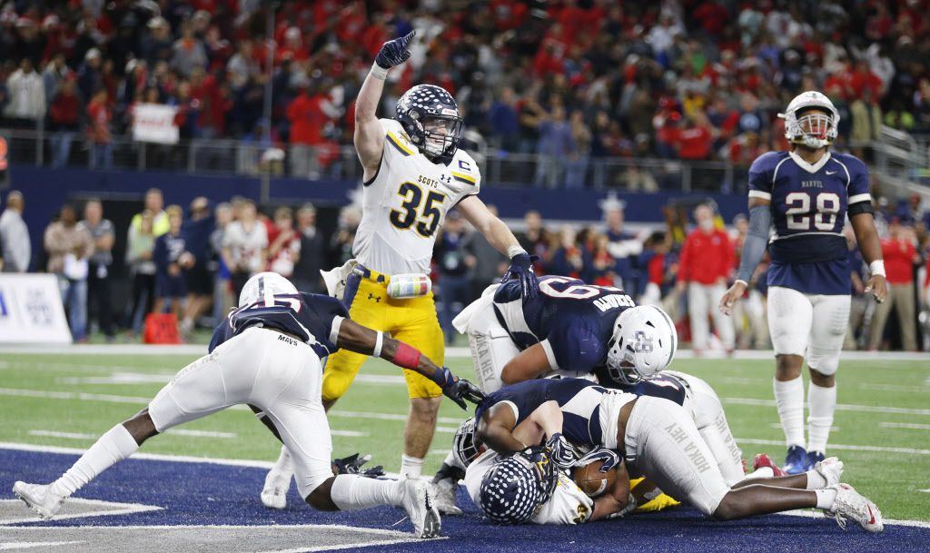 Highland Park's Paxton Alexander (35) celebrates as teammate Cade Saustad (88) scores the game winning touchdown against Manvel during the last minute of the second half of play of the UIL Class 5A Division II state football championship at AT&T Stadium in Arlington, Texas on Friday, December 22, 2017. Highland Park defeated Manvel 53-49. (Vernon Bryant/The Dallas Morning News)