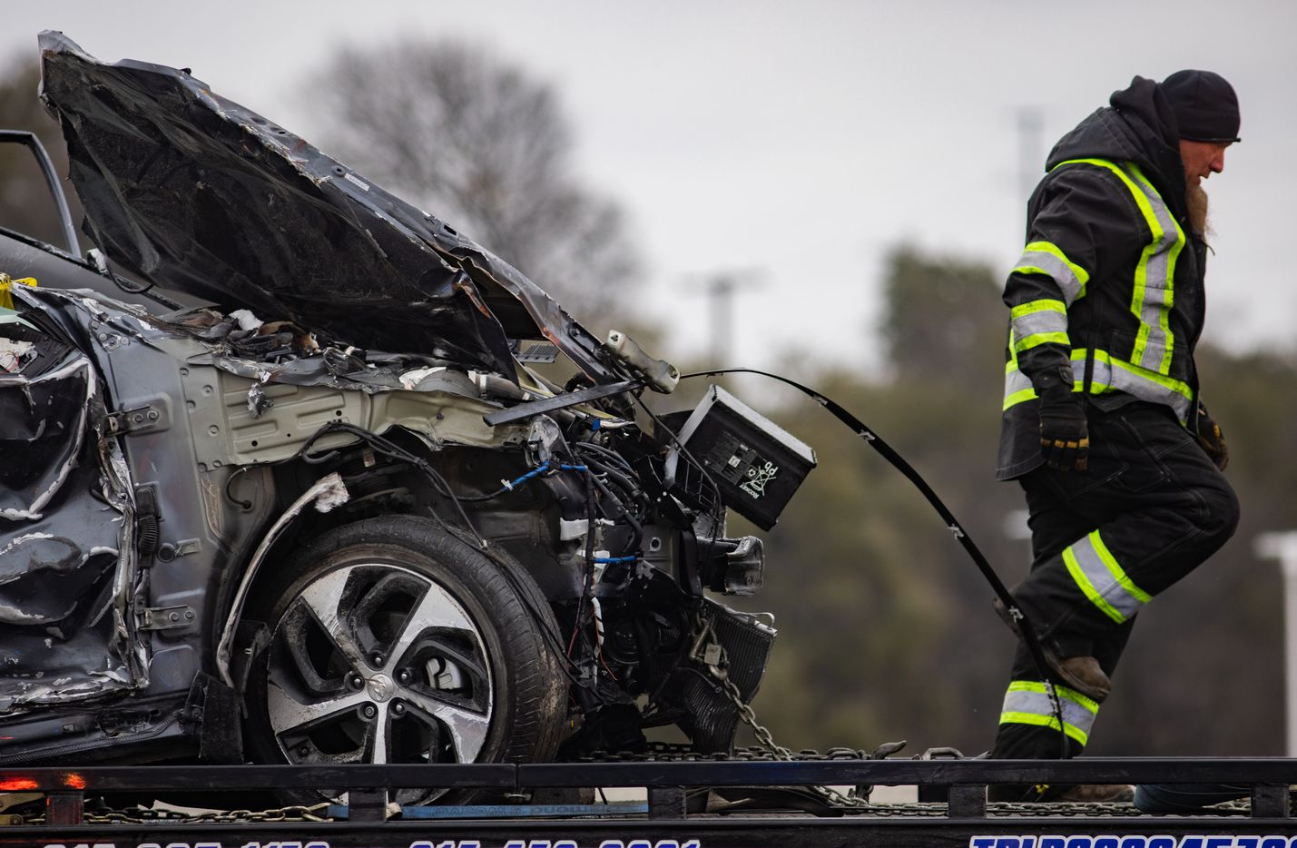 A crumbled car is towed as emergency crews work to clear the mass casualty pile-up on I-35W and Northside Drive in Fort Worth on Thursday, Feb. 11, 2021. (Juan Figueroa/ The Dallas Morning News)